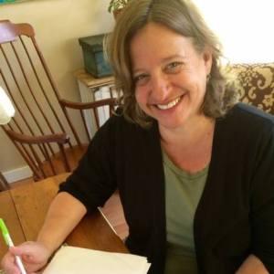 Jodi Paloni writing at desk